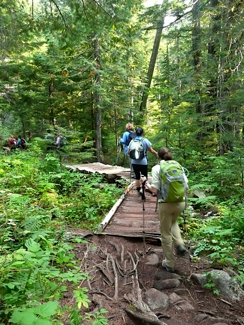Women hiking wooden walkway to Talupus Lake